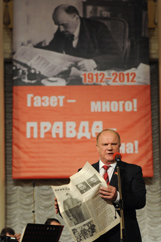 "Communist Party leader Gennady Zyuganov. The poster behind reads: ""There are many newspapers, but only one Pravda."" (RIA Novosti/Vladimir Fedorenko)"
