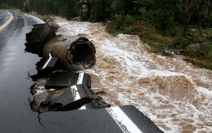 A section of Highway 72 is missing after a flash flood tore through Coal Creek near Golden, Colorado September 12, 2013 (Reuters / Rick Wilking)