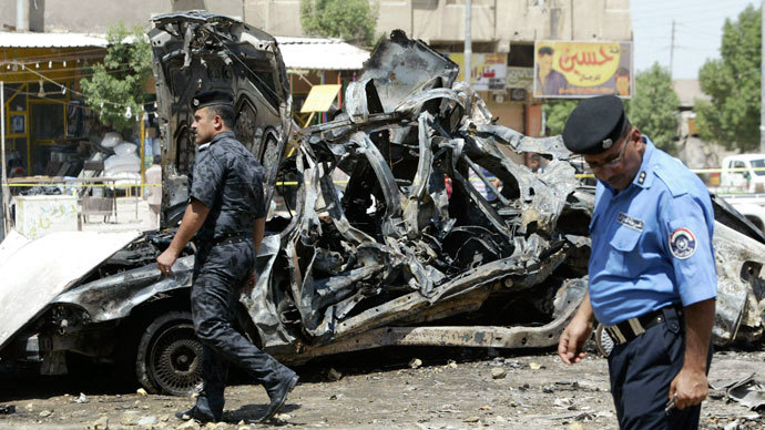 Iraqi security forces walk past damaged vehicles as they inspect the site of a car bomb attack in Basra, 420 km (261 miles) southeast of Baghdad, September 15, 2013. (Reuters / Essam Al-Sudani)