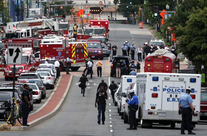 Emergency vehicles and law enforcement personnel respond to a reported shooting at an entrance to the Washington Navy Yard September 16, 2013 in Washington, DC.(AFP Photo / Alex Wong)