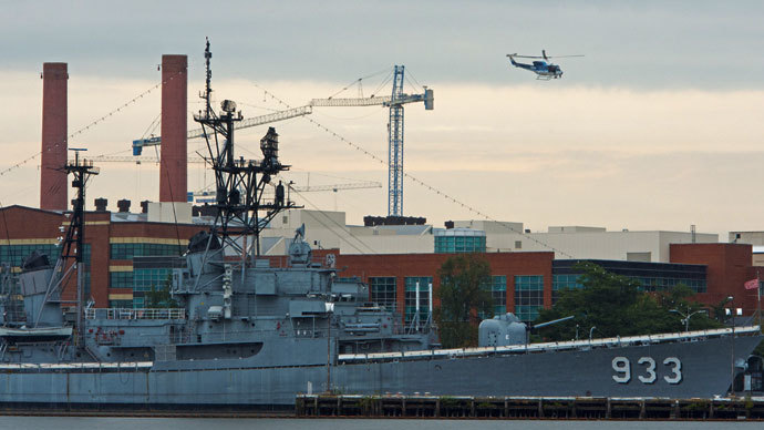 A US Park Police helicopter patrols over the US Navy Yard September 16, 2013 in Washington,DC.(AFP Photo / Paul J. Richards)