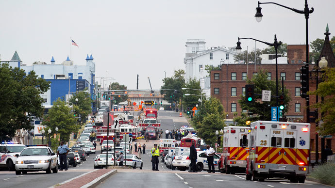 Police block off M Street, SE as they respond to a shooting at the Washington Navy Yard, in Washington September 16, 2013. (Reuters / Joshua Roberts)