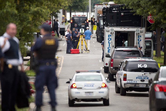 Police work in the U.S. Navy Yard after a shooting in Washington September 16, 2013 (Reuters / Joshua Roberts)