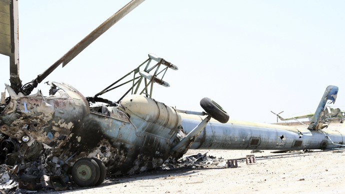 A destroyed Russian-made helicopter that belonged to the Syrian Army is seen at the Minnig Military Airport, after it was seized by rebels, August 11, 2013. (Reuters/Mahmoud Hassano)