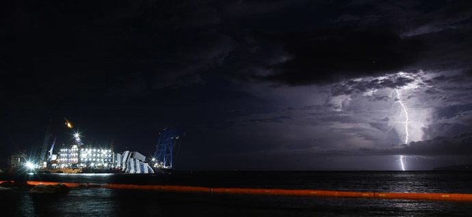 A lightning storm is pictured over the sea near the capsized cruise liner Costa Concordia, outside Giglio harbour September 15, 2013. (Reuters/Tony Gentile)