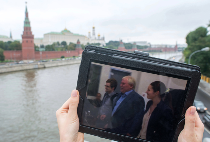 This tablet PC displays a photo of former CIA employee Edward Snowden and his lawyer Anatoly Kucherena leaving the Sheremetyevo airport. Snowden remained in the airport's transit area for over a month and was granted provisional asylum in Russia for one year (RIA Novosti / Iliya Pitalev)