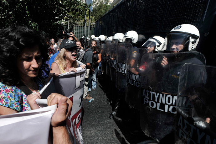 Public sector employess shout to police blocking their way to the Greek Parliament in Athens on September 18, 2013 during a 48-hours civil servants strike (AFP Photo / Louisa Gouliamaki)