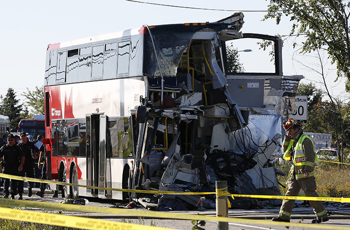 A firefighter walks in front of the scene of an accident involving a bus and a train in Ottawa September 18, 2013. (Reuters / Chris Wattie)