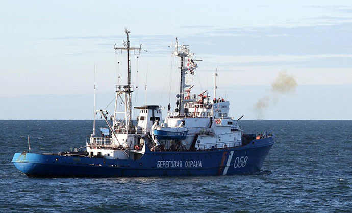 A Russian Coast Guard ship firing a warning shot to stop the Arctic Sunrise Greenpeace icebreaker during an environmentalists' attempt to climb Gazprom's 'Prirazlomnaya' Arctic oil platform on September 18, 2013. (AFP Photo / Greenpeace / Denis Sinyakov)