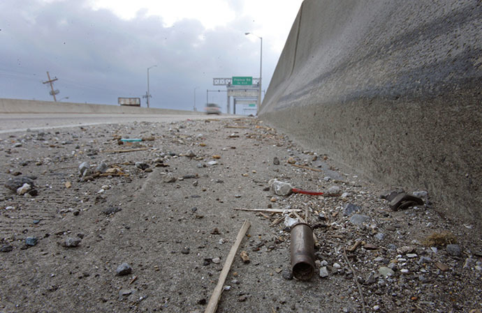 A spent shell casing lies alongside the road on Danziger Bridge in eastern New Orleans, Louisiana November 10, 2005. (Reuters / Lucas Jackson)