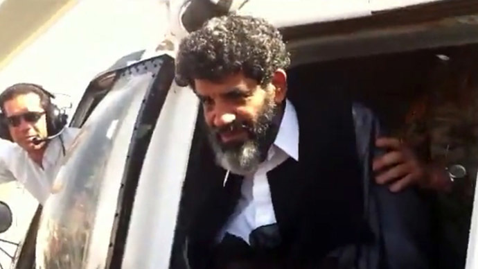 Handout video grab taken from footage shot by a member of Libyan security forces shows Abdullah al-Senussi, a former spy of late Libyan leader Muammar Gaddafi, arriving at the high security prison facility in Tripoli, on September 5, 2012. (AFP/HO)