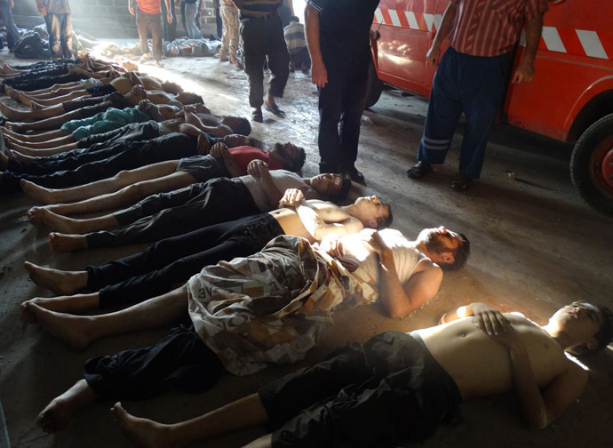A handout image released by the Syrian opposition's Shaam News Network shows bodies of boys and men lined up on the ground in the eastern Ghouta suburb of Damascus, whom the Syrian opposition said on August 21, 2013 were killed in a toxic gas attack by pro-government forces. (AFP Photo/Shaam News Network)