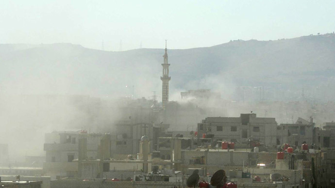 A handout image released by the Syrian opposition's Shaam News Network shows smoke above buildings following what Syrian rebels claim to be a toxic gas attack by pro-government forces in eastern Ghouta, on the outskirts of Damascus on August 21, 2013. (AFP/Shaam News Network)