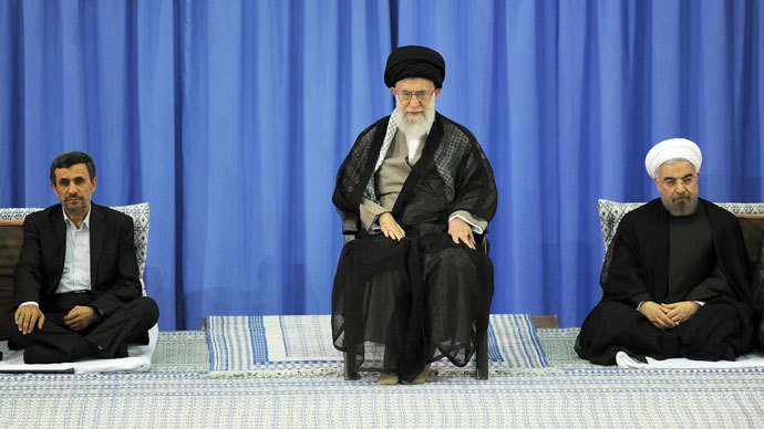 A handout picture released by the official website of the Iranian supreme leader Ayatollah Ali Khamenei on August 3, 2013, shows Khamenei (C) during a ceremony officially endorsing moderate cleric Hassan Rowhani (R) in the capital Tehran, as former president Mahmoud Ahmadinejad (L).(AFP Photo / Khamenei.Ir)