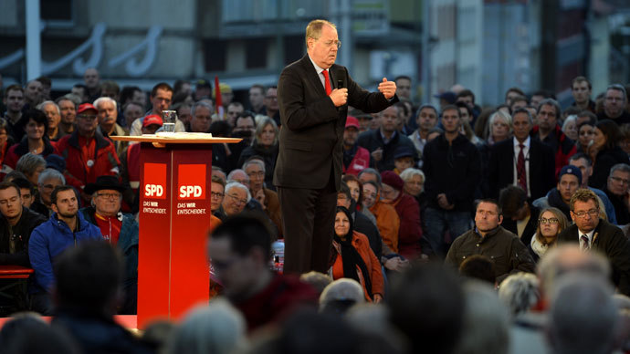 Chancellor candidate of German Social Democratic (SPD) party Peer Steinbrueck delivers his speech at an election campaign event on September 20, 2013 in Kassel.(AFP Photo / Odd Andersen)
