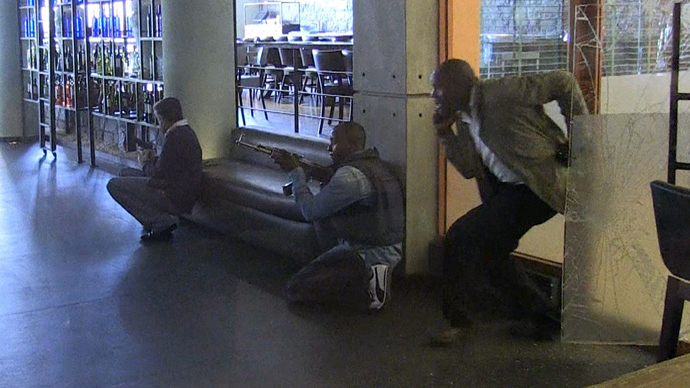 An image grab taken from AFP TV shows Kenyan security forces taking position inside a shopping mall following an attack by masked gunmen in Nairobi on September 21, 2013 (AFP Photo / AFPTV)