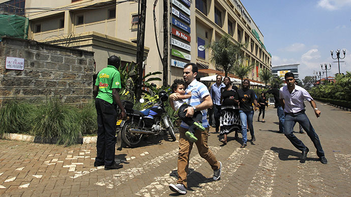 Customers run following a shootout between unidentified armed men and the police at the Westgate shopping mall in Nairobi September 21, 2013. (Reuters / Thomas Mukoya)