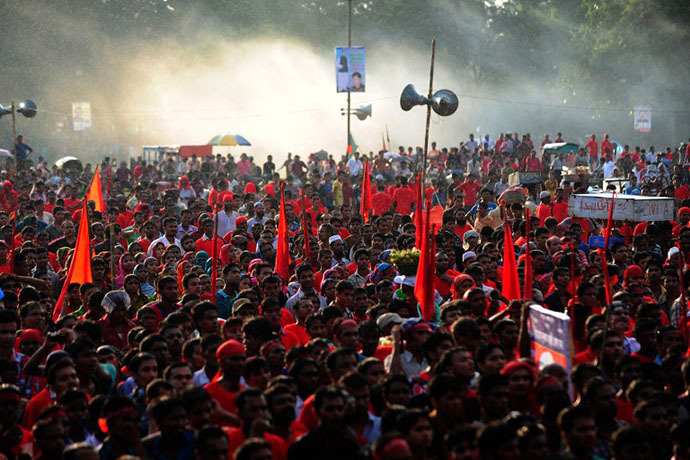 Bangladeshi garment workers shout slogans during a protest asking for wage increase in Dhaka on September 21, 2013. (AFP Photo / Munir Uz Zaman)