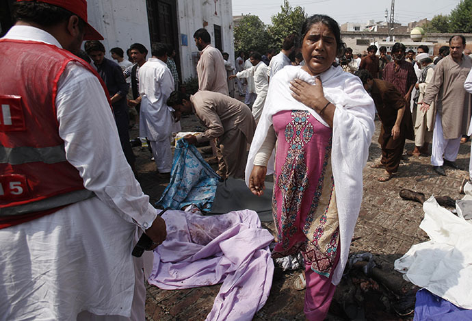 A woman mourns the death of her relatives at the site of a suicide blast at a church in Peshawar September 22, 2013. (Reuters / Fayaz Aziz)