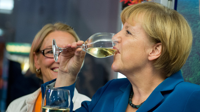 German Chancellor Angela Merkel drinks a glass of vine during the election party of her Christian Democratic Union (CDU) party at the party's headquarters in Berlin on September 22, 2013 (AFP Photo)