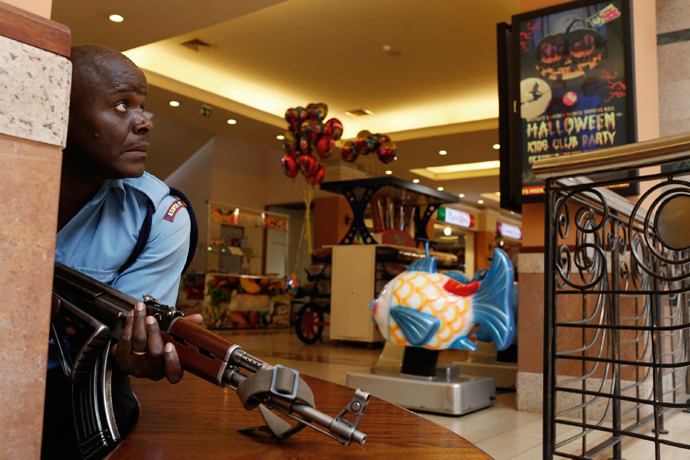 A police officer tries to secure an area inside the Westgate Shopping Centre where gunmen went on a shooting spree in Nairobi September 21, 2013 (Reuters / Siegfried Modola)