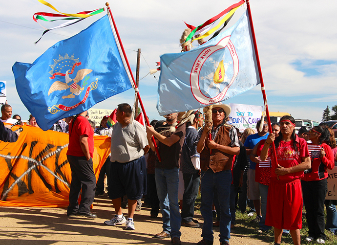 Group of protesters, including native American Indians, protest against the National Socialist Movement (NSM) in Leith, North Dakota. (Sunday, Sept. 22, 2013. Image from flickr.com user@uneditedmedia)