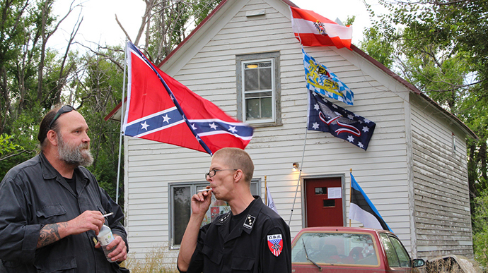 Members of NMS stand outside the home of white supremacist, Craig Cobb, who began buying up land in Leith, North Dakota to create an all-white settlement. (Image from flickr.com user@uneditedmedia)