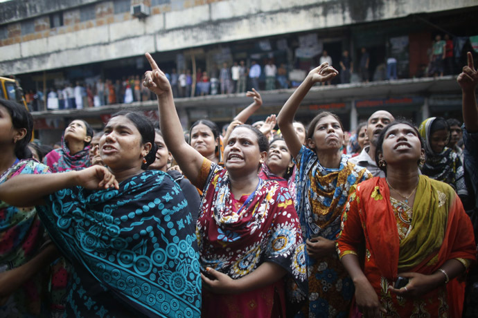 Garment workers shout as they call other workers to join them, in front of Brothers Fashion Limited, during a protest in Dhaka September 23, 2013. (Reuters/Andrew Biraj)