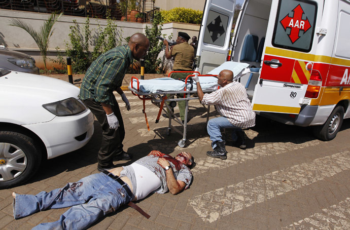 Rescuers attempt to evacuate a man injured in a shootout between armed men and the police at the Westgate shopping mall in Nairobi September 21, 2013. (Reuters/Thomas Mukoya)