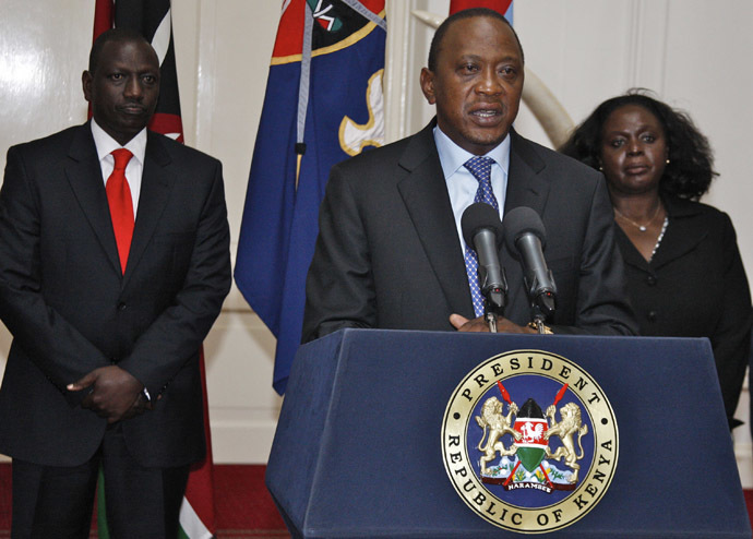 A handout picture taken and released on September 24, 2013 shows Kenyan President Uhuru Kenyatta (C) speaking during a press conference in Nairobi in front of Kenyan Vice President William Ruto (L) following an attack on the Westgate shopping mall in Nairobi. (AFP Photo)