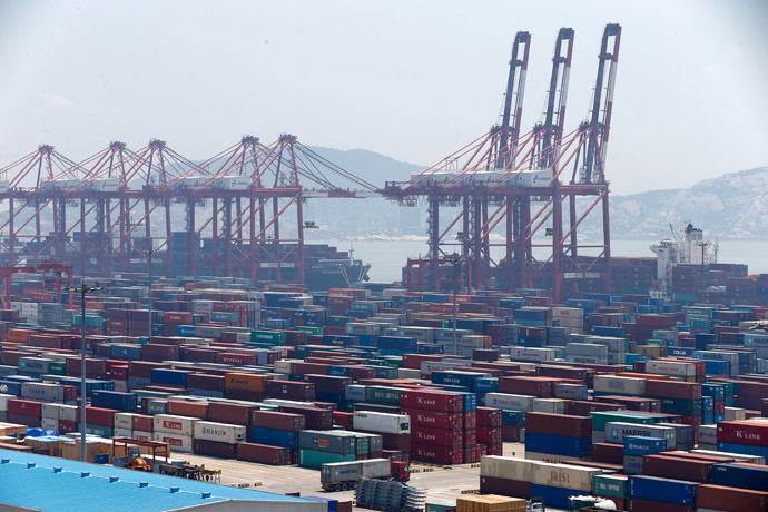 This picture taken on July 30, 2013 shows containers waiting to be transported in Yangshan port in Shanghai, one of the districts that would be included into Shanghai's free trade zone. (AFP Photo/China Out)