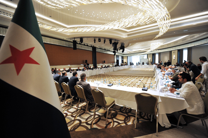 Members of Syrian National coalition (SNC) attend a meeting of the National Coalition of Syrian Revolution and Opposition forces in Istanbul (AFP Photo / Ozan Kose)
