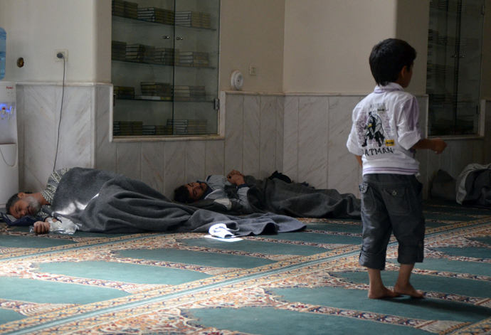 Survivors from what activists say is a gas attack rest inside a mosque in the Duma neighbourhood of Damascus August 21, 2013 (Reuters / Bassam Khabieh)