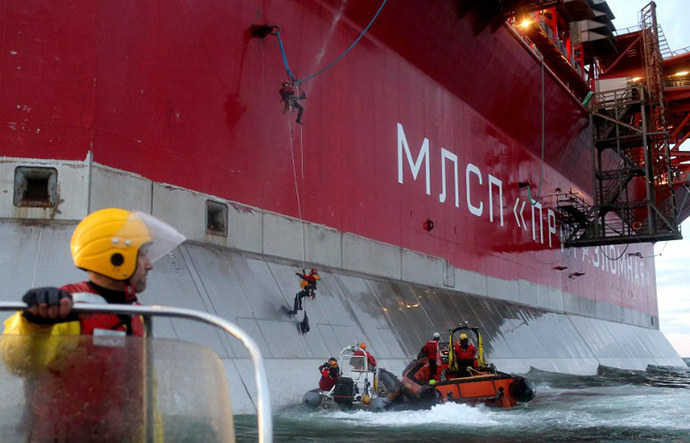 A handout photo taken by Greenpeace on September 18, 2013, shows Greenpeace activists boarding Gazprom's 'Prirazlomnaya' Arctic oil platform somewhere off Russia north-eastern coast in the Pechora Sea. (AFP Photo / Denis Sinyakov)
