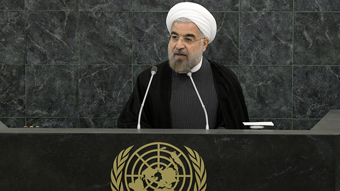 Shoes and cheers: Rouhani gets mixed reception after phone call with Obama