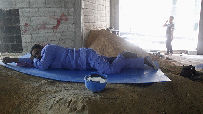 A construction worker rests during his lunch break in Doha (Reuters)