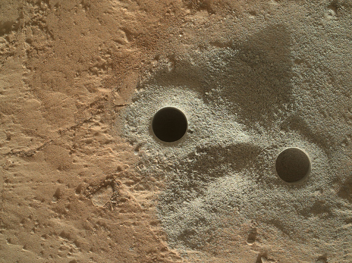 "This handout provided March 30, 2013 by NASA shows holes drilled into rock by NASA's Mars rover Curiosity in the ""Yellowknife Bay"" area of Gale Crate (AFP Photo / NASA)"