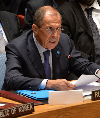 Russia's Foreign Minister Sergey Lavrov speaks in the United Nations Security Council after the Council voted to approve a resolution that will require Syria to give up its chemical weapons during a meeting September 27, 2013.(AFP Photo / Stan Honda)