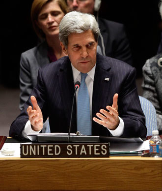 US Secretary of State John Kerry speaks after a United Nations Security Council vote September 27, 2013 at U.N. headquarters in New York City.(AFP Photo / Joshua Lott)