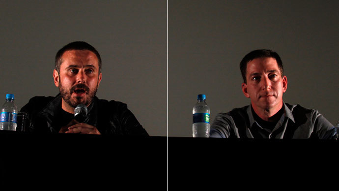 US journalists Jeremy Scahill (L) and Glenn Greenwald. (Reuters / Pilar Olivares)