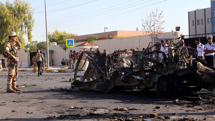 Iraqi Kurdish security forces gather at the site of a car bomb explosion in Arbil, the capital of Iraq's autonomous Kurdistan Region, on September 29, 2013. Militants killed six people, officials said, in a rare attack on an area usually spared violence plaguing the country.(AFP Photo / Safin Hamed)