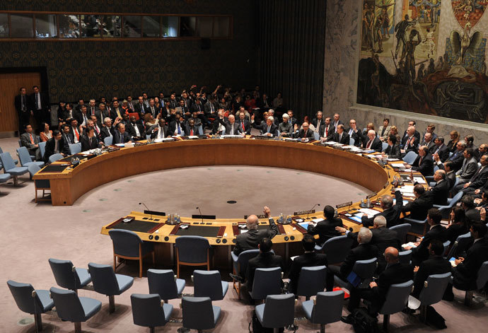 The United Nations Security Council votes to approve a resolution that will require Syria to give up its chemical weapons during a meeting September 27, 2013 at UN headquarters in New York on the sidelines of the 68th Session of the United Nations General Assembly.(AFP Photo / Stan Honda)