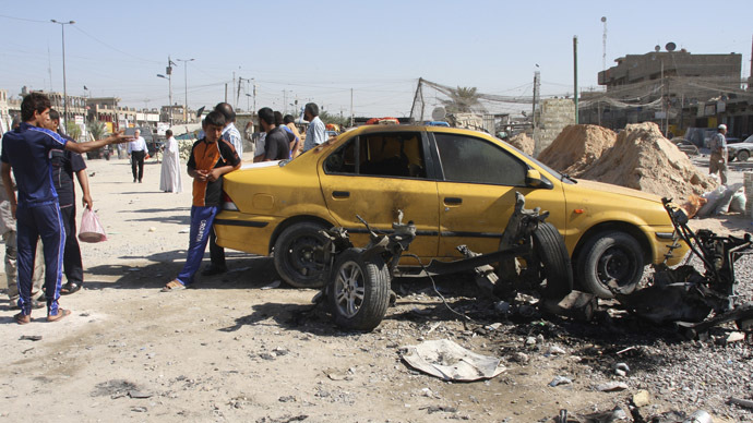 Youths inspect the site of a car bomb attack in Baghdad's Sadr City September 30, 2013. (Reuters/Wissm al-Okili)