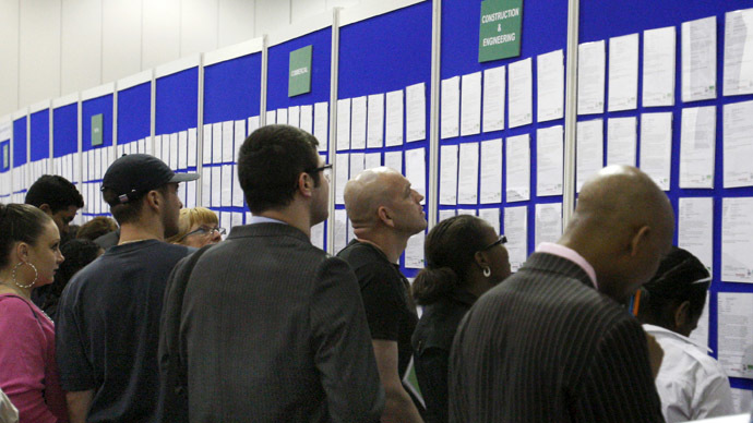 People look at job listings at the Careers and Jobs Live careers fair at the ExCeL centre in London (Reuters/Luke MacGregor)