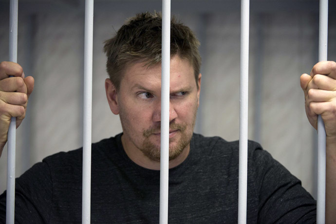 This handout picture released on September 29, 2013 by Greenpeace International shows Greenpeace activist Anthony Perret from the United Kingdom at the Leninsky district Court of Murmansk. (AFP Photo/Dmitri Sharomov)