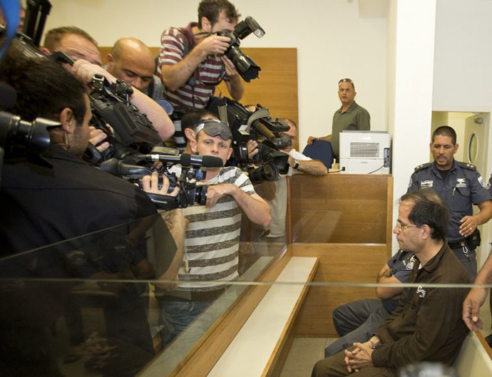 Ali Mansouri, 58, arrested at Ben Gurion Airport on suspicion of espionage, is photographed as he sits at the Petah Tikva District Court on the first day of their trial on September 30, 2013. (AFP Photo / Jack Guez)