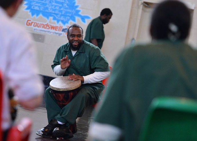 Rikers Island inmate Salideen Ali takes part in a drum performance as The National Association Of Music Merchants (NAMM) NAMM Presents First Ever National Music Day And Make Music NY at Rikers Island on June 21, 2013 in New York City. (AFP Photo / Stephen Lovekin)