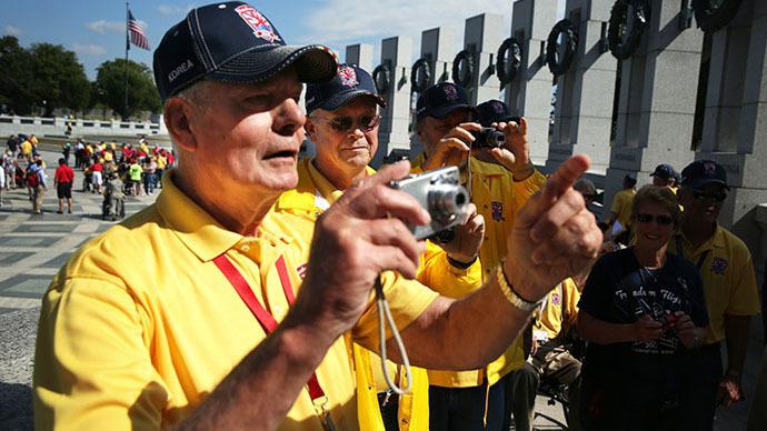 Veterans push past barricades to visit closed WWII memorial amid govt shutdown