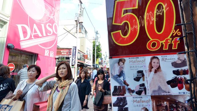 Japan pokes ballooning debt, hikes sales tax