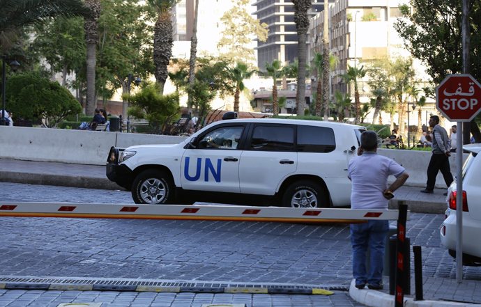 A United Nations vehicle is seen outside a hotel in Damascus on October 1, 2013 as a chemical weapons disarmament team arrived in the Syrian capital to begin the task of inventorying the country's arsenal of the banned weapons in readiness for its destruction (AFP Photo / Louai Beshara)